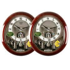 Rhythm Musical Wall Clock With Moving Dial Pendulum And Swarovski