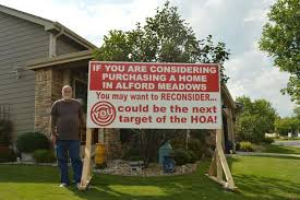 Resident constructs large sign in front yard to spite homeowners
