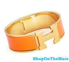 hermes h clic clac hermes 18k gold plated clic clac h bracelet orange enamel