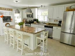 White Classic Kitchen With A Touch Of Cottage Style