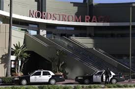 A Los Angeles Police Department officer stands near his vehicle outside the Nordstrom Rack store in the Westchester area of Los Angeles January 11 2013