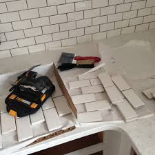 the backsplash is sheets of 2 4 inch subway tile from home depot
