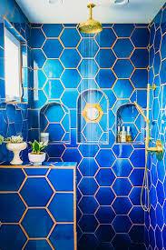 justina blakeney bathroom blue tile gold shower jungalowjungalow