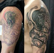 Here Is Another Plan Of Covering Up A Tribal Tattoo With Bigger And Darker Ancient