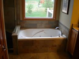 whirlpool tub with custom tile removable skirt ideas for the