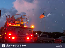 A Fire Truck With Lights On Near An American Flag At Night With Pink ... Flashing Emergency Lights Of Fire Trucks Illuminate Street West Fire Truck At Night Stock Photo Image Lighting Firetruck 27395908 Ladder Passes Siren Scene See 2nd Aerial No Mess Light Pating Explained Led Lights Canada Night Winter Christmas Light Parade Dtown Hd 045 Fdny Responding 24 On Hotel Little Tikes Truck Bed Wall Stickers Monster Pinterest Beds For For Ambulance And Firetruck Gta5modscom Nursery Decor How To Turn A Into Lamp Acerbic Resonance Art Ideas Explore 16 20 Photos 2 By Fantasystock Deviantart