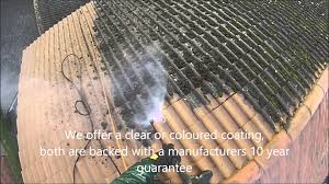 roof cleaning in the uk removing moss from concrete roof tiles
