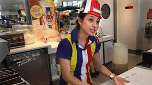 Alexia Haakma Calls Out An Order Ready At The Hot Dog On A Stick Franchise