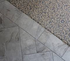 why does a carpeted floor feel warmer to bare than tile or