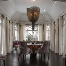 Grand Dining Room With Vaulted Ceiling Dramatic Curtains And Chandelier