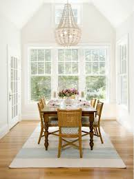 Vaulted Dining Area Room With Chandelier Over Table