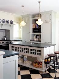 White Cabinets Dark Gray Countertops by White Gray Countertop Island With Shelves Island Wine Rack Black