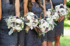 Bridesmaids In Short Lace Dresses With Garden Flowers