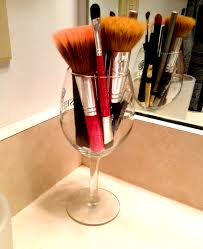 For an easy makeup brush storage idea use an old wine glass Just