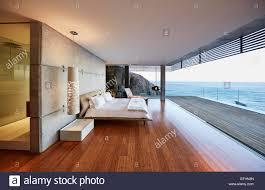 100 Modern Luxury Bedroom Luxury Bedroom Open To Patio With Ocean View Stock