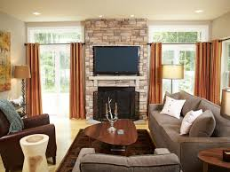 crown molding rounded windows built in bookcases stone fireplace
