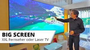 großer fernseher im wohnzimmer kino oder mehr schein als sein 75 led vs 100 zoll laser tv