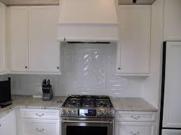 rock backsplash tile inexpensive white cabinets mid century knobs