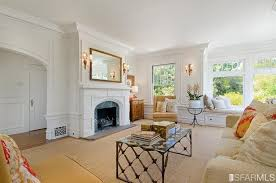 Living Room With Fireplace And Bay Window by Traditional Living Room With Wainscoting U0026 Stone Fireplace In San