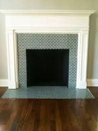 before after herringbone tile fireplace renovation in a 1918