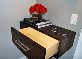 square dark brown wooden bedside table with single drawer of