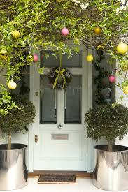 baubles hung around front door outdoor christmas light ideas