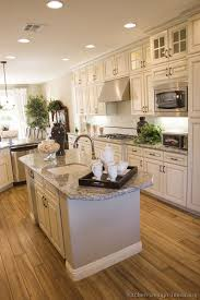 Kitchens With White Cabinets And Wood Floors Distressed Kitchen