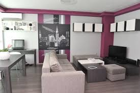 Tiny Apartment In Sofia With Wall Graphic Details Shop This Look Canvas Couch Coffee Table