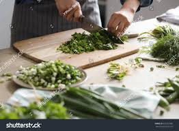 cooking chef cuisine cooking chef cutting greens kitchen stock photo 655762906