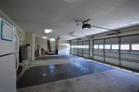 All Floors Carpet by Contemporary Garage With Carpet U0026 High Ceiling In Jacksonville Fl