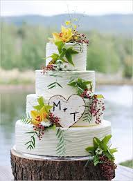 Rustic Wedding Cake With Carved Wood Initials And Tree Trunk Base Cute But Different Flowers