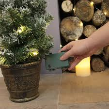 Flocked Artificial Pre Lit Christmas Trees by 60cm Pre Lit Battery Snow Covered Potted Christmas Tree With Timer
