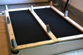 add boards to bottom of box spring cover in fabric and add some