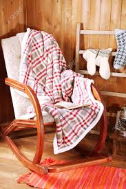Rocking Chair With Plaid And Book Near Wooden Wall Update A Nursery Glider Rocking Chair The Diy Mommy Nosew Reversible Cushions Momadvice Upholstered Home Decor Mom Amazoncom Janist Cotton Tatami Futon Pads Quilted Comfy And Lovely Plans Royals Courage Equal Portable Easy Folding Recling Zero Gravity How To Recover Your Outdoor Quick Jennifer Pdf To Make A Ding Cushion Free Free Ship Or Set In Navy Blue And Aqua Damask On White Heart Dutailier Replace Baby 10 Best Rocking Chairs Ipdent