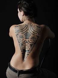 Photo Tattoo Tribal Female Back Up Center Reverse Triangle Polynesian Motifs