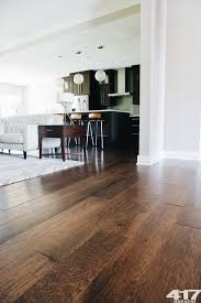 the contrast of the wood flooring and white walls
