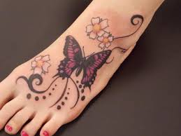 Beautiful Black And Pink Floral Butterfly Tattoo On Foot