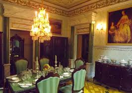 Victorian Style Dining Room With Striped Chairs And Chandelier Wall Art Curio Cabinet Dresser