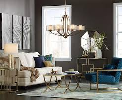 Gold Finish Lighting And Furniture Lends Sparkle To A Living Room