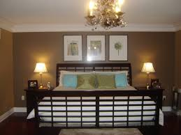 Brushed Brass Antique Bedroom Chandelier Over Black Iron Bed Frame Also Cool Wall Color In Vintage Master