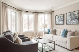 cream sofa with blue pillows transitional living room blue