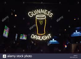 Guinness Draught Beer neon light in window of Irish Pub in