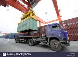 100 Southwest Truck And Trailer FILEA Container Crane Unloads A Truck At The Chengdu