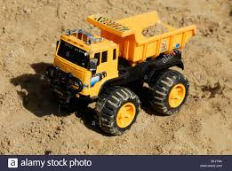 Toy Dump Truck Sand Pit Stock Photo: 18241590 - Alamy Tonka Classic Dump Truck Big W American Plastic Toys Gigantic Walmartcom Funrise Toy Toughest Mighty New Hess And Loader For 2017 Is Here Toyqueencom Moover Little Earth Nest Wooden Trucks Cars Happy Go Ducky Yellow Toy Dump Truck Isolated On White Background Stock Photo Photos Pictures Getty Images Amazoncom 16 Assorted Colors Metal Kmartnz Bruder Mack Granite Games