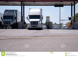 Semi Trucks Are At The Gas Station For Refueling Stock Photo - Image ... Mini Truck Camper Canopy Bed Ideas Truck Canopy Camping Setup Best Resource General Shelving Package Service Trucks Ute Pro Top Tops Hardtops For The Hard Working Pickup Turns Your And Topper Into A Popup Shells Sale In Utahtruck Edmton Bed Buyers Guide 2015 Medium Duty Work Info Hilux Alinium Toyota 4x4 Pinterest Mx Series Cap Are Caps And Tonneau Covers Youtube Canopies
