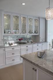 Modern Kitchen Design With Kris Kardashian Mirrored Cabinet Mosaic Tile Backsplash