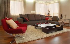 brown sofa and red chairs in a modern living room interior design