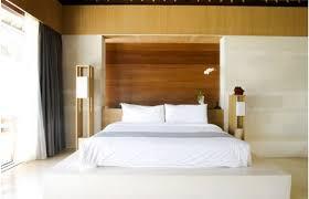 Sleek Zen Bedroom With Wood Panels Headboard Also White Bedding