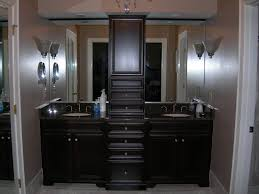 black wooden bathroom double vanity with high cabinet and double