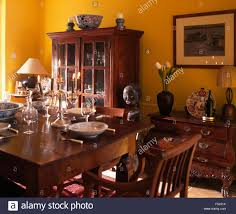 100 Heavy Wood Dining Room Chairs Wood Vintage Table Set For Lunch In A Yellow Nineties Dining